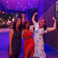 Anna, Alicia, and I flex for the marquee